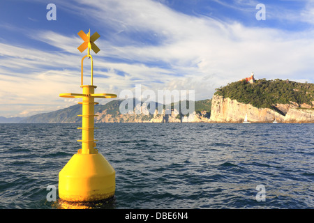 floating yellow buoy on mediterranean coast in front of portovenere, la spezia, italy - Stock Photo