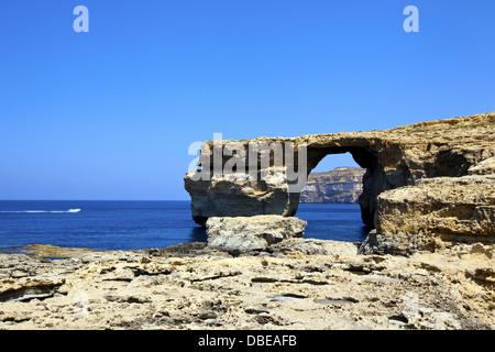 Famous tourist attraction Azure Window, famous stone arch on Gozo island, Malta - Stock Photo