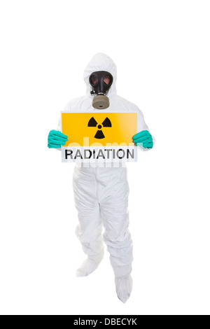 A man in a hazmat suit holding a sign - Stock Photo
