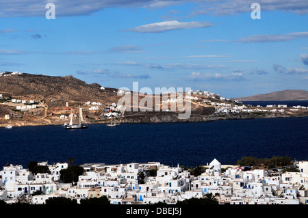 Whitewashed town buildings and boats in the bay, Mykonos, South Aegean, Greece, Europe. - Stock Photo