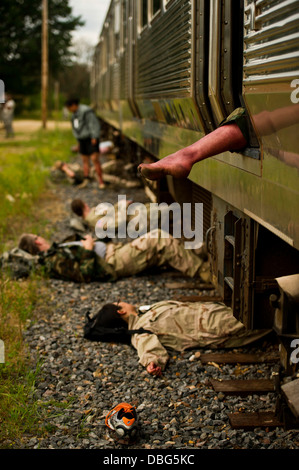 U.S. Army Soldiers role play as victims of a simulated mass casualties scenario in support of Warrior Exercise 86 - Stock Photo