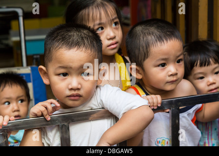 Young children at a daycare center in Saigon, Ho Chi Minh City, Vietnam, Asia. - Stock Photo