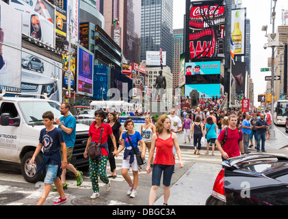 Busy Times Square in Manhattan, New York City street with crowds of people / tourists in summer - Stock Photo