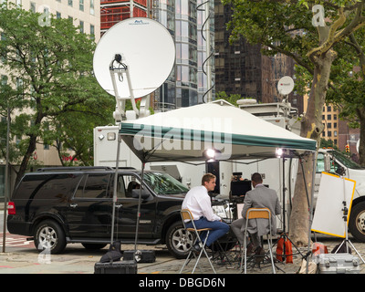 A TV outside broadcast unit working in NYC - Stock Photo