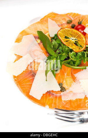 carpaccio of salmon on a table in a restaurant - Stock Photo