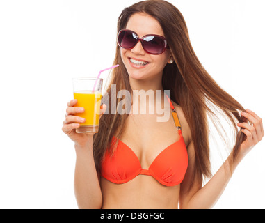 Young smiling woman with sunglasses drinks orange juice in summer, isolated on white - Stock Photo
