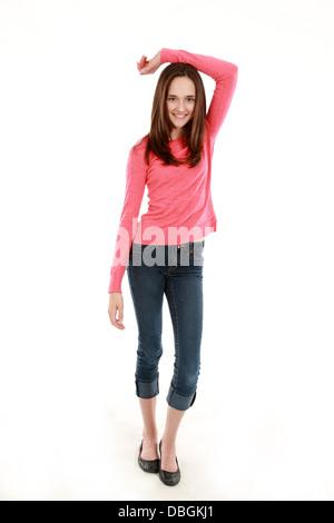 full length of thin brunette tween girl smiling - Stock Photo