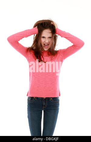 3/4 shot of thin young teen girl screaming - Stock Photo
