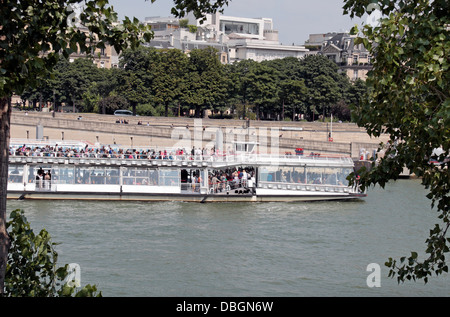 A tourist boat cruise on the River Seine, Paris, France. - Stock Photo