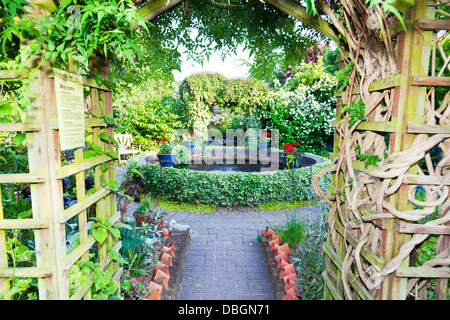 Typical English garden Arbour Arch archway Canop trellis - Stock Photo