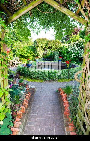 Typical English garden Arbour Arch archway Canopy - Stock Photo