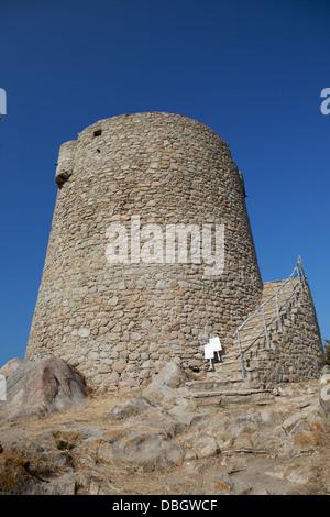 Ancient Spanish tower at Vignola Mare - Stock Photo
