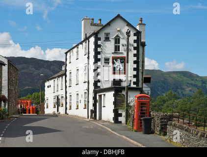 Man delivering Calor Gas bottles to the White Lion Inn, Patterdale, Lake District National Park, Cumbria, England - Stock Photo
