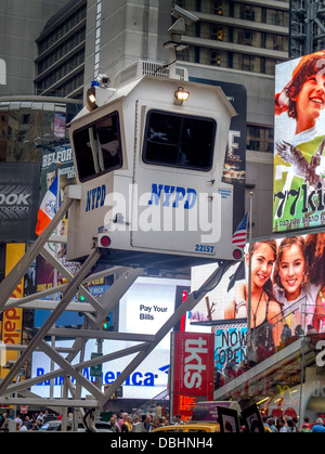Police monitor activity in Times Square, New York City, from a mobile guard tower - Stock Photo