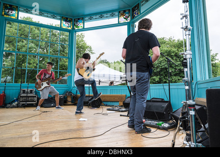 Band playing inside Victorian bandstand at Sheffield Tramlines festival in Western park Sheffield South Yorkshire - Stock Photo