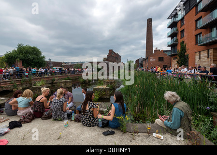 Crowds of people listening to bands in Kelham Island Sheffield South Yorkshire England at  Tramlines music festival - Stock Photo