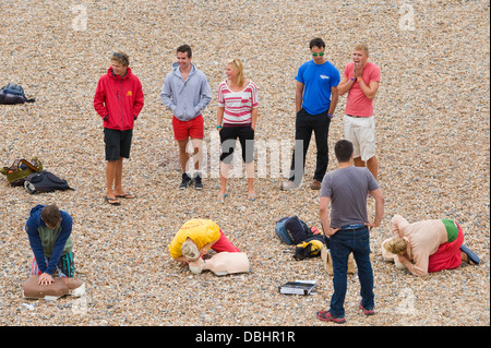 Life guards on first aid course on seafront in Brighton East Sussex England UK - Stock Photo