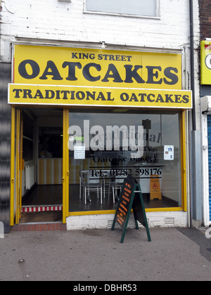 Exterior of a traditional Stoke / Staffordshire Oatcake shop, with bright yellow frontage. - Stock Photo