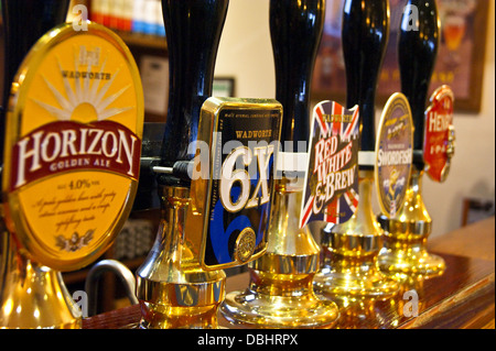 Wadworth of Devizes real ale handpumps and pump clips on a pub bar - Stock Photo