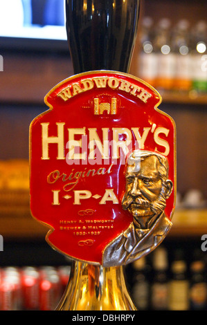 Wadworth of Devizes Henry's IPA real ale handpumps and pump clips on a pub bar - Stock Photo