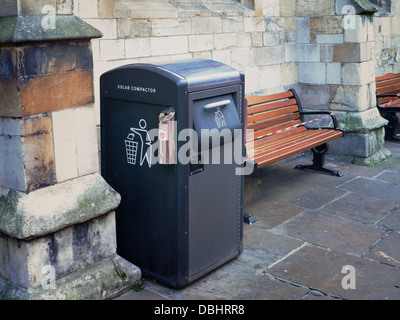 A 'Solar Compactor' litter bin uses solar energy to compact down waste, increasing its capacity compared to standard - Stock Photo
