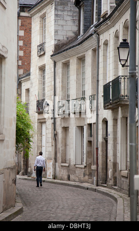 Lone male walking down a cobbled street in the old part of Tours, central France - Stock Photo
