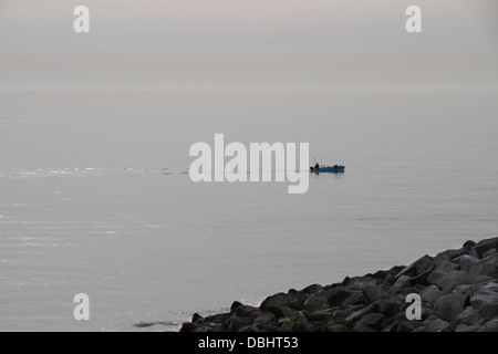 Fishing Boat passes by on a early misty morning at Kingsdown Kent UK - Stock Photo