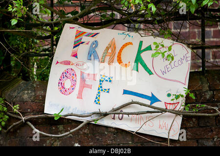 Balcombe, West Sussex, UK. 31st July, 2013. Frack off sign outside Balcombe station with arrow pointing to protest against Cuadrilla drilling & fracking. Balcombe, West Sussex, UK. Credit:  martyn wheatley/Alamy Live News