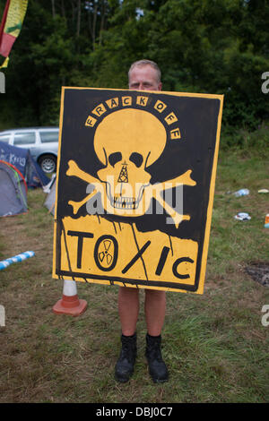 Balcombe, West Sussex, UK. 31st July, 2013. Man holds toxic placard at protest against Cuadrilla drilling & fracking just outside the village of Balcombe in West Sussex. Balcombe, West Sussex, UK. Credit:  martyn wheatley/Alamy Live News