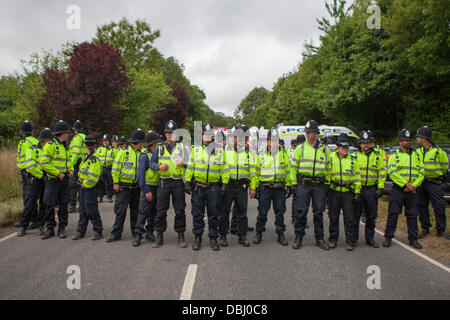 Balcombe, West Sussex, UK. 31st July, 2013. Sussex police form line across the road at protest against Cuadrilla drilling & fracking just outside the village of Balcombe in West Sussex. Balcombe, West Sussex, UK. Credit:  martyn wheatley/Alamy Live News