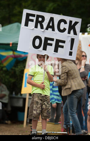 Balcombe, West Sussex, UK. 31st July, 2013. Young boy holding placard reading 'Frack Off!'.Protest against Cuadrilla drilling & fracking just outside the village of Balcombe in West Sussex. Balcombe, West Sussex, UK. Credit:  martyn wheatley/Alamy Live News