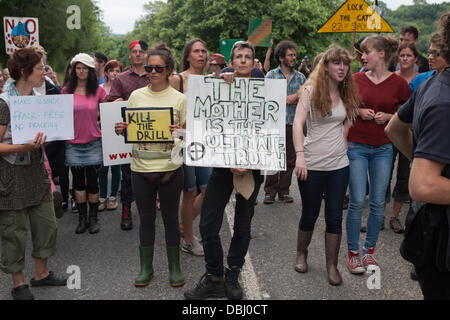 Balcombe, West Sussex, UK. 31st July, 2013. Protesters holding placards block the London Road. Protest against Cuadrilla drilling & fracking just outside the village of Balcombe in West Sussex. Balcombe, West Sussex, UK. Credit:  martyn wheatley/Alamy Live News