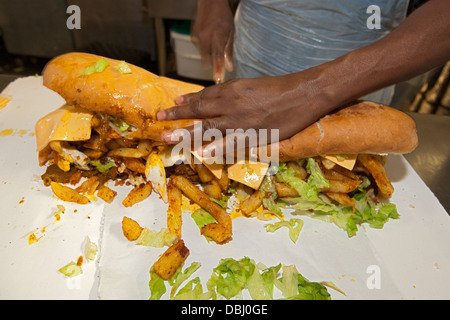 Full House gatsby sandwich being prepared at the Golden Dish take away in Athlone, Cape Town, South Africa. - Stock Photo