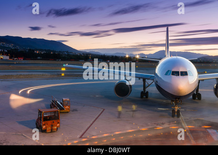 A budget airline prepares it's aircraft for take off from Malaga airport in southern Spain. - Stock Photo