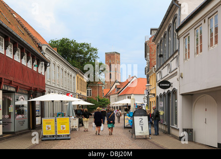 Pizza restaurant and shops on pedestrianised main cobbled street in historic town centre. Overdamme, Ribe, Jutland, - Stock Photo