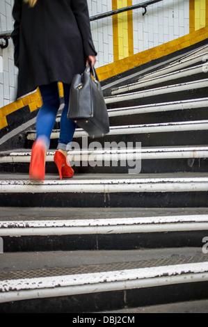 Woman on steps, Covent Garden Underground station, London, United Kingdom - Stock Photo