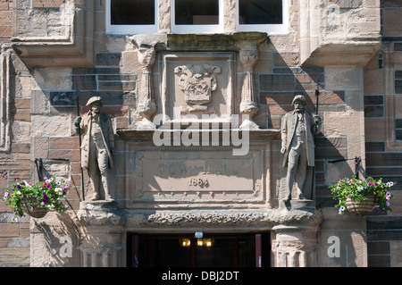 Carving over the entrance to Kirkwall Town Hall, Orkney. - Stock Photo