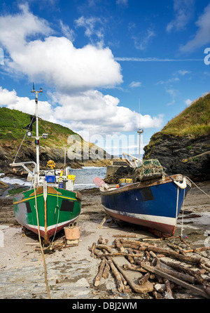 Colourful fishing boats on the beach at Portloe a small fishing village on the south coast of Cornwall - Stock Photo