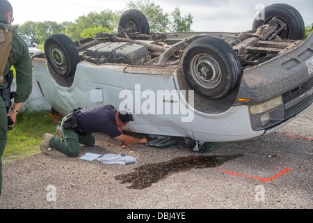 Falfurrias, Texas - An van holding 26 undocumented immigrants from Central America overturned on Texas Highway 285. - Stock Photo