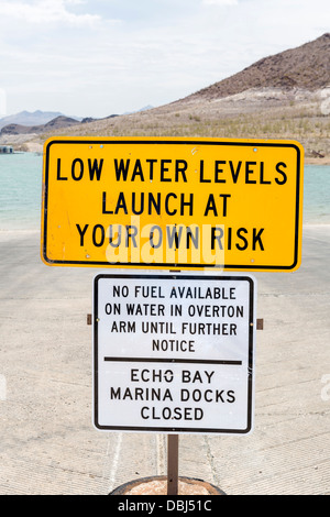 Warning of low water levels on boat ramp at Lake Mead in summer 2013, Echo Bay Marina, Lake Mead, Nevada, USA - Stock Photo