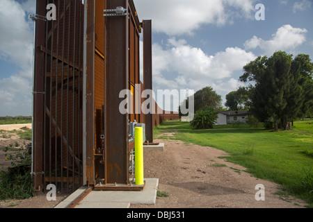 Fence at U.S.-Mexico Border - Stock Photo