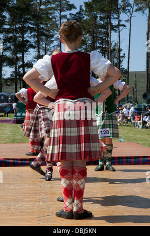 Highland reel dancers,  kilt, dancing, national, plaid, skirt, culture,  at the annual Tomintoul Highland games - Stock Photo