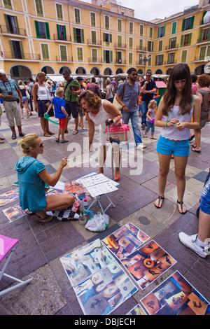 Street artist in the main square, Plaça Major, in Palma de Mallorca. - Stock Photo