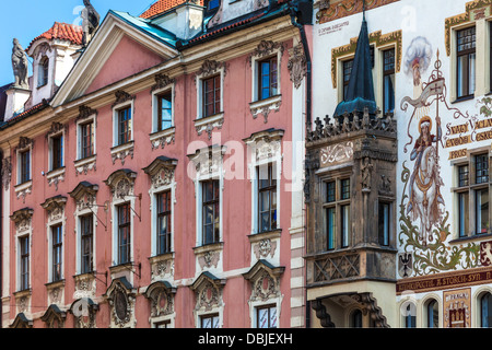 Ornate facades of buildings around the Old Town Square in Prague with Storch House and mural of St Wenceslas on - Stock Photo