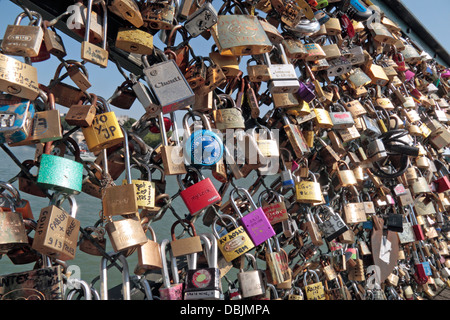 100's of 'love padlocks' on Pont des Arts (Passerelle des Arts), a pedestrian bridge in over the River Seine, Paris, - Stock Photo