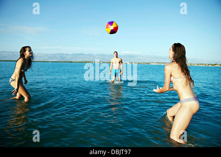 People On Beach Playing Beach Volleyball - Stock Photo