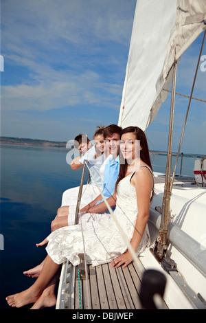 Croatia, Two young couples on sailboat having fun - Stock Photo