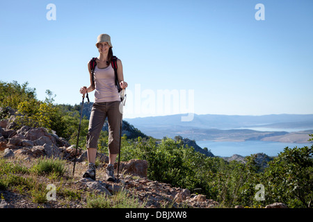 Croatia, Paklenica, Female hiker in mountain scenery - Stock Photo