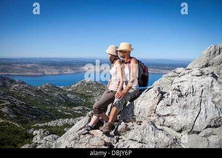 Croatia, Paklenica, Couple in mountain scenery - Stock Photo