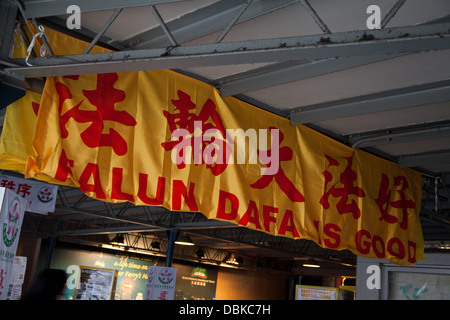 Fa Lun Gong signs star ferry complex kowloon - Stock Photo